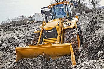 Hydrema 926F backhoe loader shoveling soil with the front loader